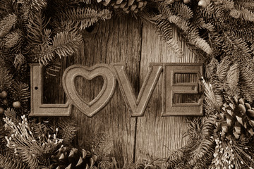 Love in Text in the center of a Christmas Wreath