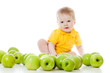 Smiling baby with many green apples