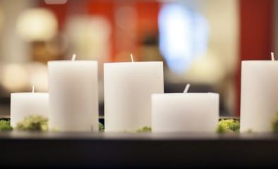 Group of white thick candles.
