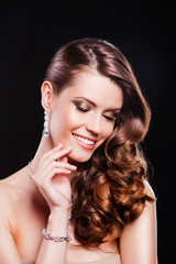 portrait of a beautiful smiling brunette girl with luxury