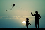 father and son with kite - 74273186