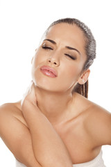 Portrait of beautiful young woman with neck pain