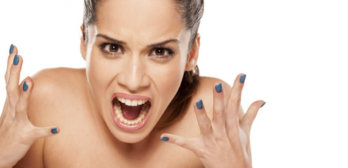 portrait of beautiful  angry woman on a white background