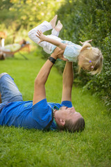 Little girl playing outdoor with her father