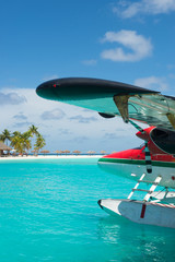 Sea plane, tropical beach resort