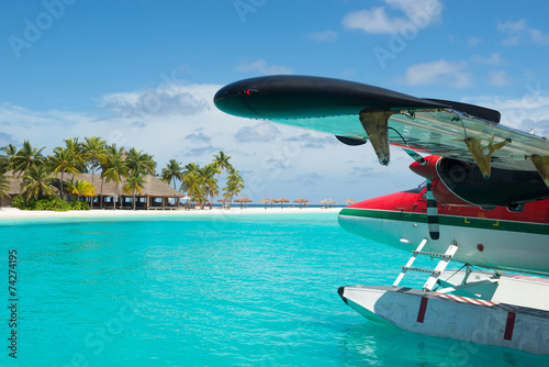 Sea plane, tropical beach resort - 74274195