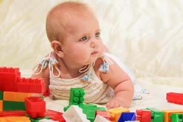 Baby plays with building bricks.