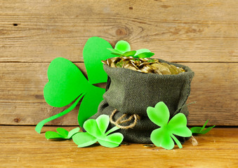 green clover leaves and a bag of gold St. Patrick's Day