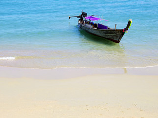 Tropical beach, longtail boats,