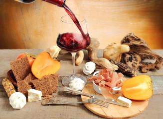 wine tasting with persimmon, meringue, parma ham, cereal bread a
