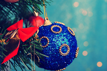 Toys on Christmas tree on  Christmas lights background