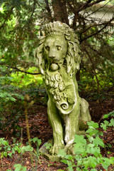 old Lion Statue in a Garden
