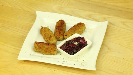 Cutlets with cranberry sauce