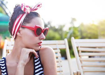 Beautiful pin up girl near the swimming pool