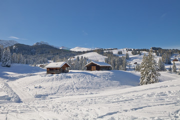 Typical wooden chalet in the Dolomites mountain in winter