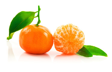 Ripe tangerine with leaves