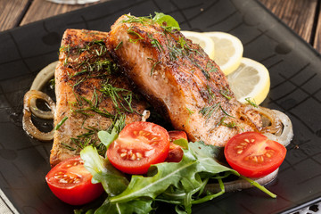 Fried salmon steak with vegetables