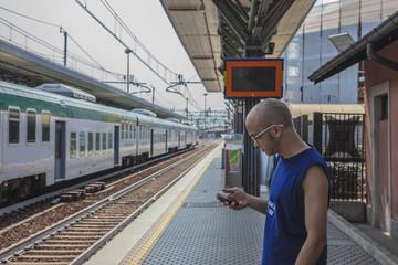 Man waits at the train station