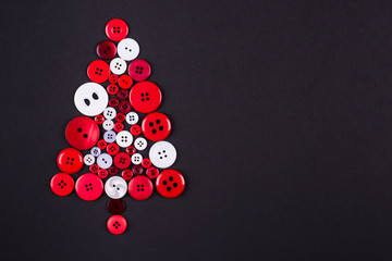 Buttons tree, Xmas background, isolated on dark, copy space