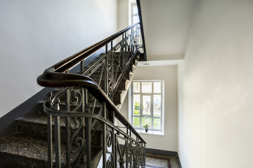 Staircase with old, decorative railing