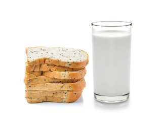 Glass of milk and whole wheat bread isolated on white background