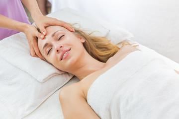 woman having spa massage of her head
