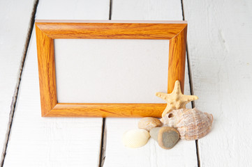 Picture frame with blank space inside and shells