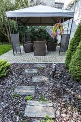 Beauty garden with wicker furniture