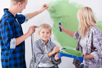 Loving family painting wall together