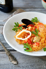 Risotto with meat mussels and rice on a bowl