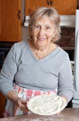 Grandma making meat pies