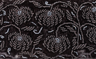 vintage embroidery by black beads on black velvet