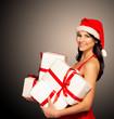 Santa hat Christmas woman holding christmas gifts