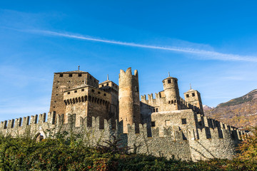 Wall and towers of Fenis Castle in Aosta Valley