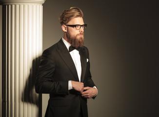 elegant business man closing his jacket.