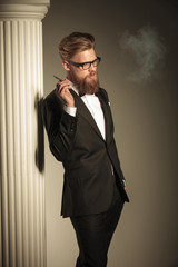 business man enjoying his cigarette