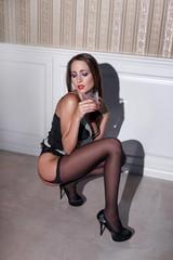 Sensual woman in underwear drink whiskey
