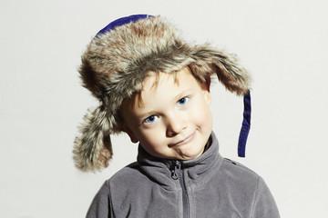 funny child in fur Hat.fashion winter.little boy.hat ear flaps
