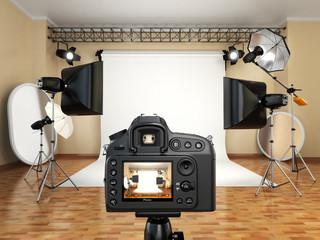 DSLR camera in photo studio with lighting equipment, softbox and
