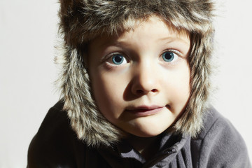 Funny child in fur Hat.winter style.little boy.children emotion