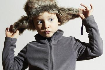 funny child in fur Hat.Kids fashion casual winter.little boy