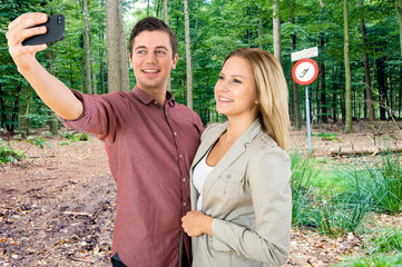 Couple taking a selfie in a No Cell phone area