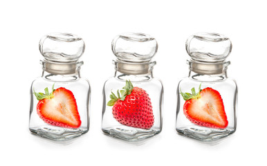 Strawberry in the  glass bottle