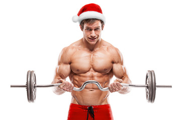 Muscular bodybuilder Santa Claus doing exercises with dumbbells
