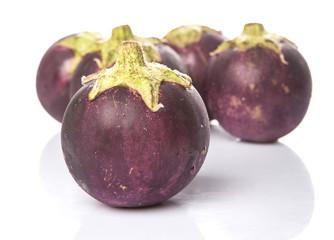 Round shape eggplant over white background
