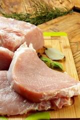 pork chop on a wooden chopping board