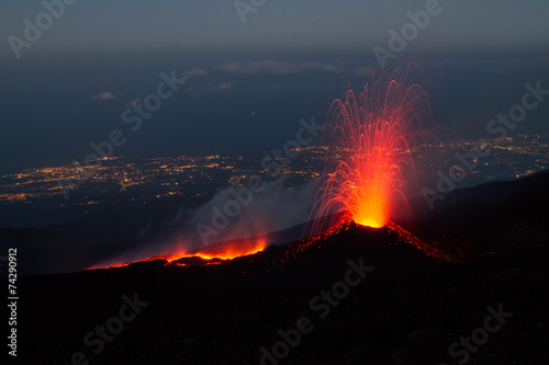 Leinwandbild Motiv Mount Etna produces fountain of lava and ash during continued er