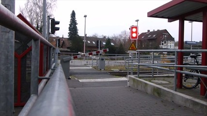 Pedestrian railway level crossing barriers closing