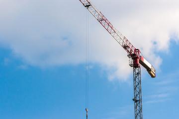 Industrial construction crane hoisting.