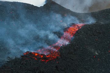 Mount Etna produces fountain of lava and ash during continued er